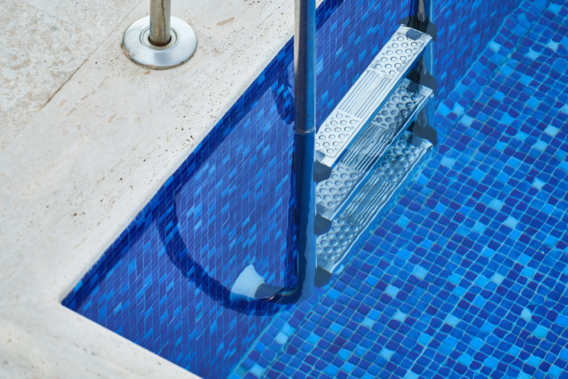 a blue pool and ladder